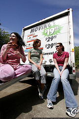three women on a moving truck